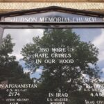 Judson Memorial Church signpost remembers the neighborhood's recent hate-crime victims